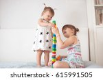 two cute siblings sisters play...   Shutterstock . vector #615991505