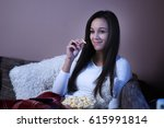 woman watching film | Shutterstock . vector #615991814