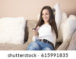 woman watching tv | Shutterstock . vector #615991835