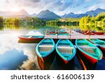 boat on the dock surrounded... | Shutterstock . vector #616006139
