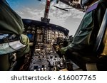 Small photo of Control panel in military helicopter cockpit, copter dashboard with displays, dials, buttons, switches, faders, knobs, other toggle items, air force, modern aviation and aerospace industry