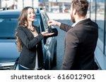 happy female customer receiving ... | Shutterstock . vector #616012901