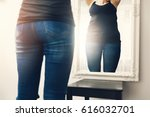 anorexia concept   woman looks... | Shutterstock . vector #616032701