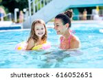 mother and daughter in swimming ... | Shutterstock . vector #616052651
