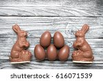 chocolate easter bunnies with... | Shutterstock . vector #616071539
