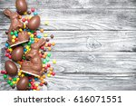 chocolate easter bunnies with... | Shutterstock . vector #616071551