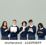 group of diverse students using ... | Shutterstock . vector #616090859