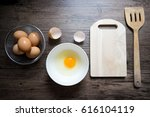 Raw Egg In A Bowl With Wooden...