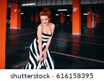 the elegance lady stands in the ... | Shutterstock . vector #616158395