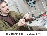 male jeweller is working at... | Shutterstock . vector #61617649