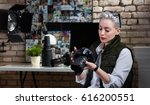 young female photographer... | Shutterstock . vector #616200551