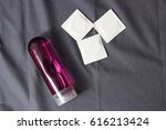 Stock photo intimate lubrication and condoms on the fabric background 616213424