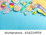 Stock photo baby accessories background baby jumpsuit socks soother and toys over grey background with copy 616214954