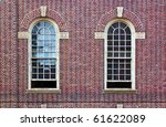 Two Arched Windows In Brick Wall