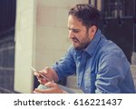 angry man looking at his mobile ... | Shutterstock . vector #616221437