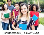 caucasian female student with... | Shutterstock . vector #616240655