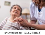 nurse holding the hand of an... | Shutterstock . vector #616245815