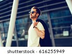 fashionable man in urban setting | Shutterstock . vector #616255949