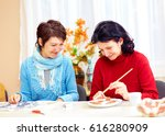 Small photo of adult woman with special needs are engaged in handcraft in rehabilitation center