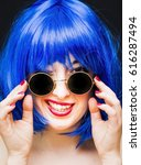 beauty woman with blue wig and...   Shutterstock . vector #616287494