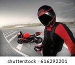 biker in helmet stands with red ... | Shutterstock . vector #616292201