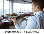 waiter with dish in uniform at... | Shutterstock . vector #616304969