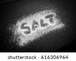 salt grains with salt word  | Shutterstock . vector #616306964
