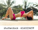 sexy girl in a swimsuit lies on ... | Shutterstock . vector #616323659