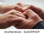 men's hands hold the female...   Shutterstock . vector #616349429