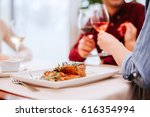 young friends having lunch in a ... | Shutterstock . vector #616354994