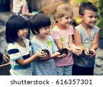 group of kindergarten kids... | Shutterstock . vector #616357301
