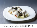 rolled herring with onion on... | Shutterstock . vector #616365011