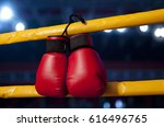 pair of red boxing gloves hangs ... | Shutterstock . vector #616496765