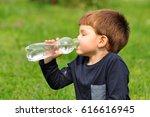 little boy drinks water from... | Shutterstock . vector #616616945