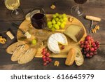 a photo of a wine and cheese... | Shutterstock . vector #616645979