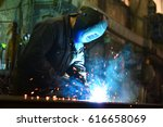 welders working at the factory... | Shutterstock . vector #616658069