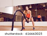 battle rope exercise at gym | Shutterstock . vector #616663025