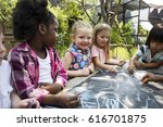 group of diverse kids drawing... | Shutterstock . vector #616701875