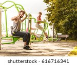 active young man exercising on... | Shutterstock . vector #616716341