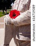 Small photo of Lest We Forget - Anzac - Rememberance - Lest We Forget in arms of memorial soldier