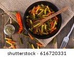 colorful dried fusilli pasta ... | Shutterstock . vector #616720331