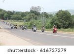 Small photo of Rustenburg, South Africa - March 3, 2017: Long line of motorbikes travelling through city streets at Yearly Mass Ride of Tainted Souls Motorbike Club, Rustenburg, South Africa.