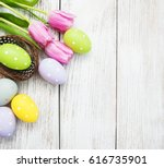 Nest with easter eggs  on a old wooden table