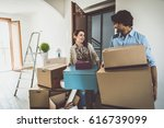 young couple moving in into new ... | Shutterstock . vector #616739099
