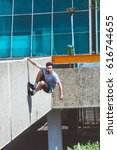 young man doing parkour in... | Shutterstock . vector #616744655