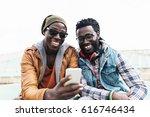 two black race friends having... | Shutterstock . vector #616746434