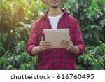 farmer using digital tablet... | Shutterstock . vector #616760495