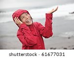 Woman In Red Raincoat Enjoying...