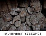 a lot of face of buddha statue | Shutterstock . vector #616810475