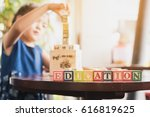 child building wood blocks at... | Shutterstock . vector #616819625